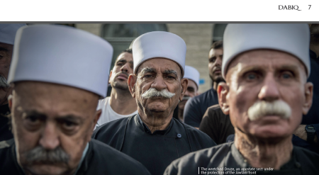 An image of Druze men from the 10th issue of IS' Dabiq magazine, with a caption disparaging them