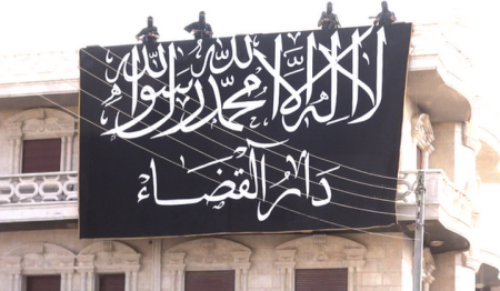 The flag of Dar al-Qadaa, the Nusra-backed court network in Syria