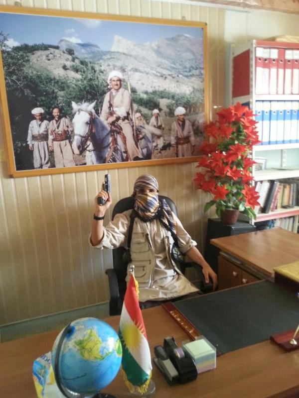 An IS jihadist makes himself at home inside Peshmerga headquarters in Sinjar