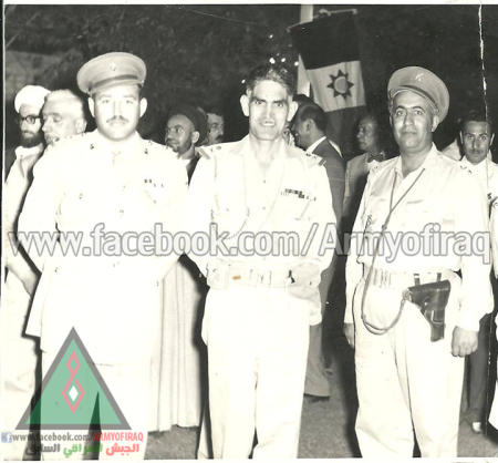 Nassif Jassem al-Samerai stands to the left of Iraqi President Abd al-Karim Qasim in the late 1950s