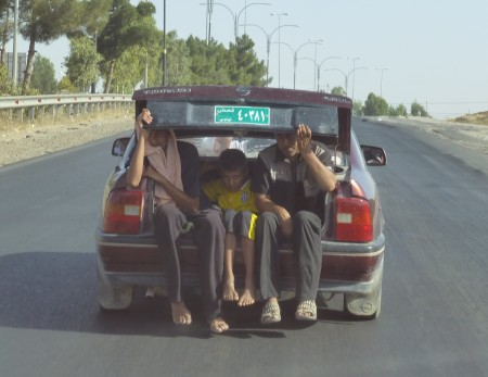Yazidis flee Sinjar in overcrowded car, barefoot—photo: Matthew Barber, Syria Comment