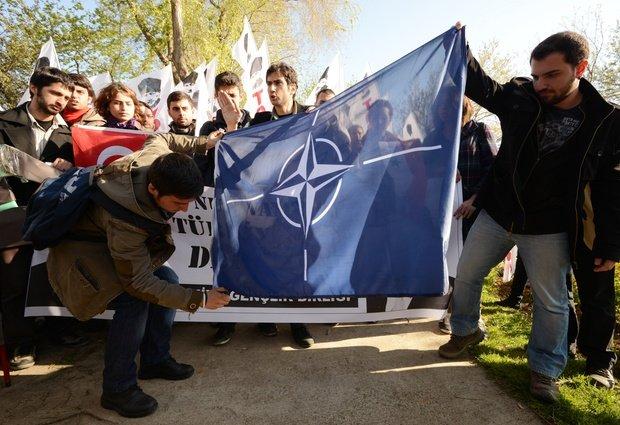 Turkish Opposition Burn NATO Flag - AP