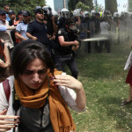 Turkish police spray woman in a red dress in the face with tear gas Gezi Park