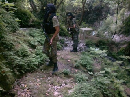 Two Libyan fighters in the lush forests of rural Latakia