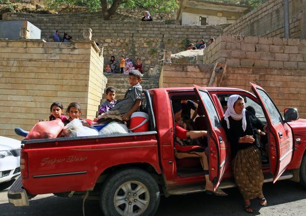 Photo: Rudaw - Yezidi IDPs (internally displaced persons) arrive in Lalish
