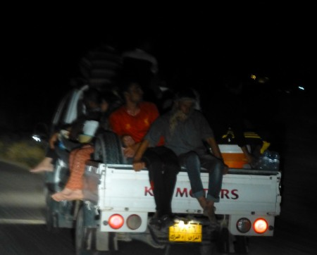 Final stragglers flee Shariya at night, Aug 7, 2014—Photo: Matthew Barber/Syria Comment