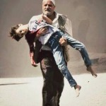 man carrying dead child in Syria